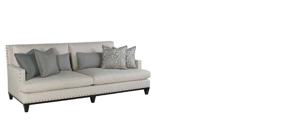 stylish white couch with nailhead trim