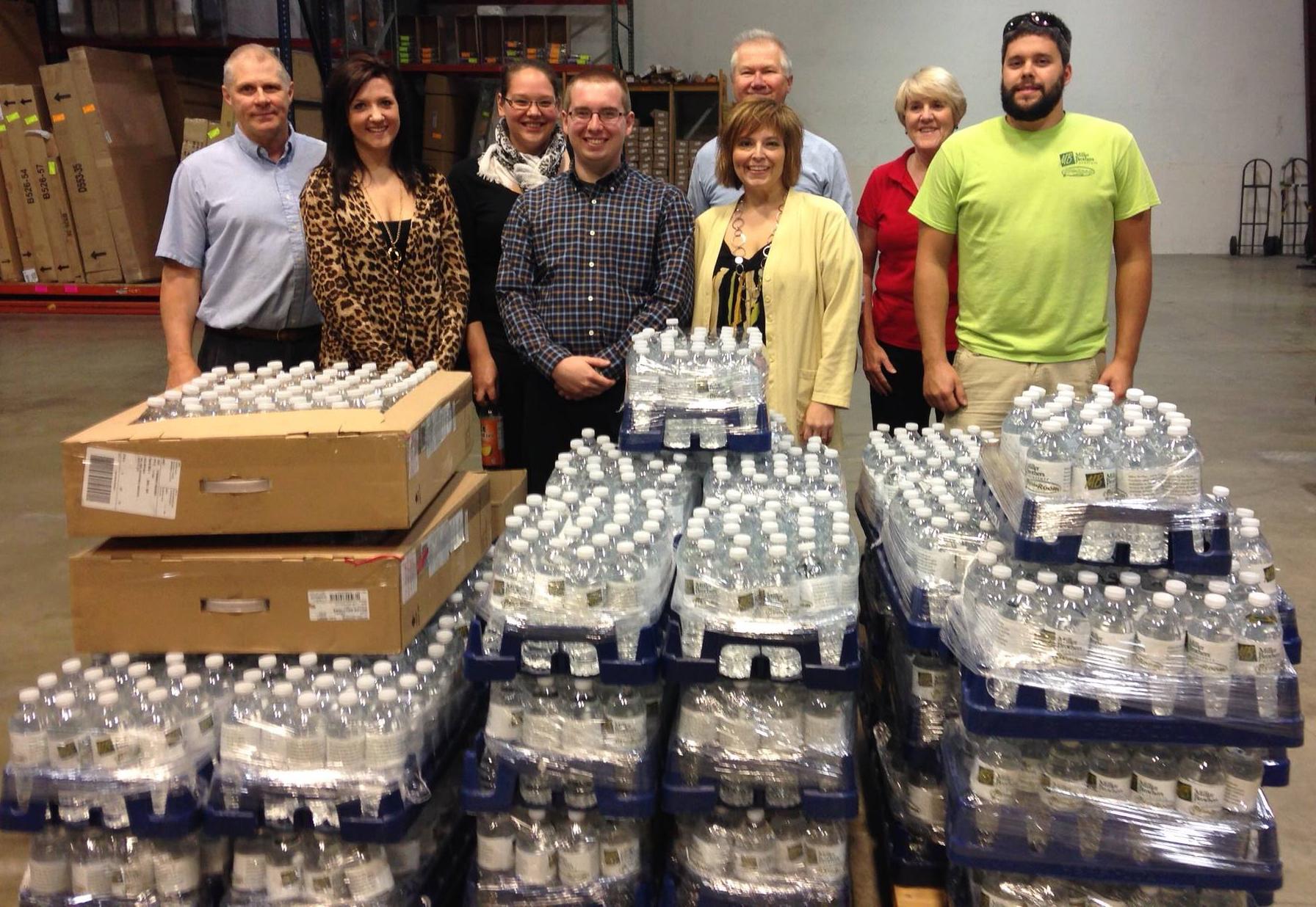 Miller Brothers team donating waterbottles