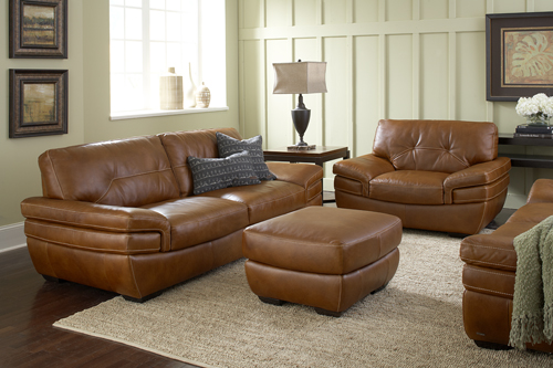 Burnt Orange Sofa, Chair, And Ottoman