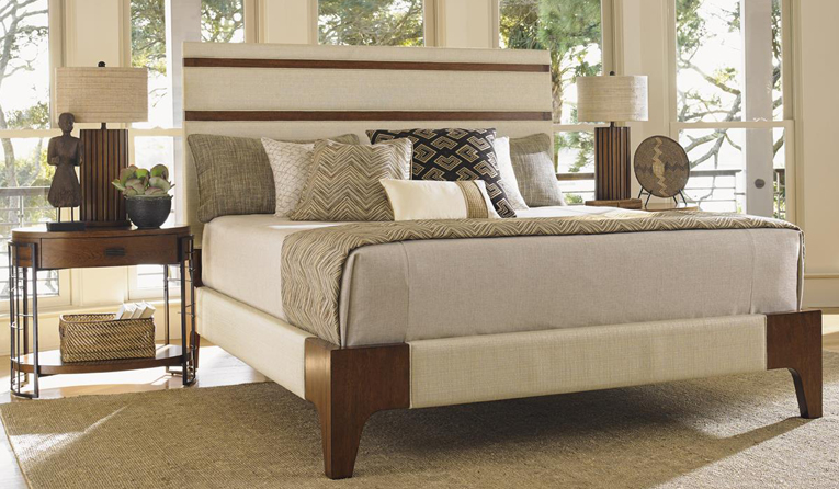 Tan Upholstered Bed with Wood Legs