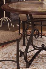 Features a Round Table Top with a Scrolled Pedestal Base