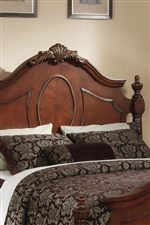 Ornate Carvings, Oval Motifs and Antique Nailhead Trim Add to the Traditional Appeal of this Collection