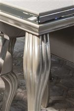 Beautifully Beveled Details add an Element of Whimsy to Many of the Dining Pieces