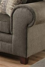 Thick Rounded Arms with Soft Padded Arm Rests Add Casual Comfort to a Classic Styled Accent