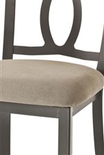 Sturdy Metal Strength Meets Soft Padded Upholstery, Creating Quaint Cottage Design Through the Combination of Opposites
