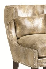 Rich Materials Like Molded Metallic Leather and Nickel Nailheads