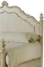 Carved Apron Detail and Finials Shown on Panel Bed Headboard
