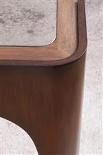 The brass Veneer legs complement the mahogany veneer coloring in the frame.