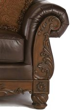 Exposed Wood Rolled Arms with Plush Upholstering and Exquisite Detailing on the Sofa.