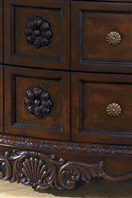 Embossed Wood Flowers and Wood Aprons with Flower like Drawer Handles on the Dresser