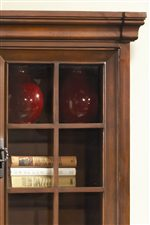 Thick Stepped Crown Moldings and Window Pane Glass Door are Found Throughout the Collection