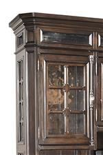 Seeded glass, cremone door hardware, and crown moulding creates gorgeous Old World styling