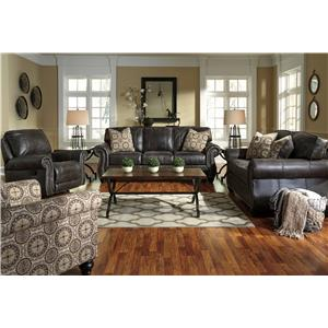 Benchcraft Breville Faux Leather Loveseat with Rolled Arms & Nailhead Trim