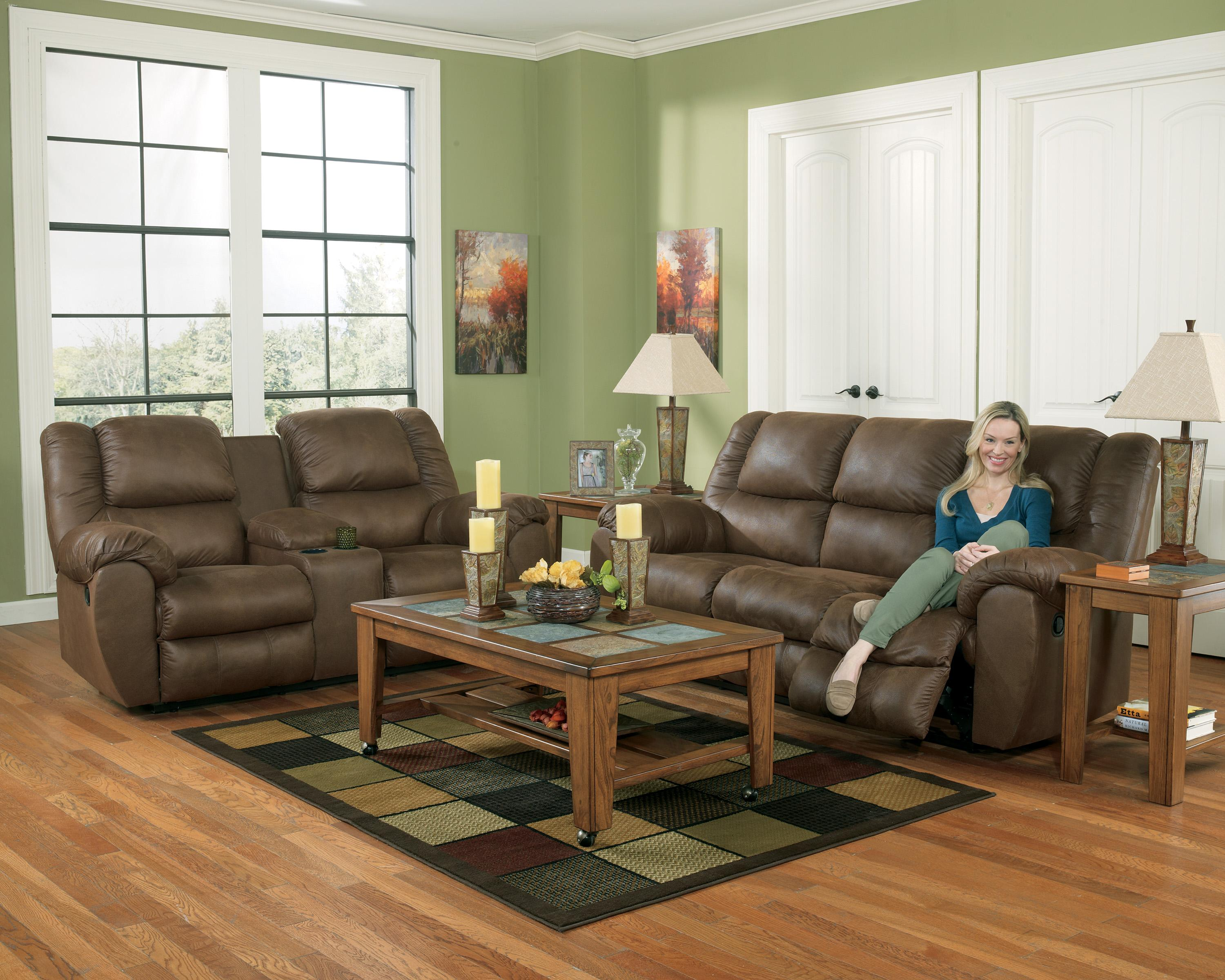 Benchcraft Quarterback Canyon Reclining Sofa in Faux Brown