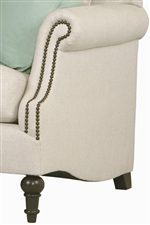 Petite rolled arms with double nailhead trim creates an upscale look