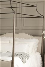 A Metal Canopy on the Canopy Bed Pairs Perfectly with the Tapered Wood Posts