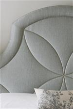 Inlaid Metal Patterns on Bed and Select Tables Give Subtle Shine