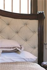 Button Tufting on the Upholstered Sleigh Bed Adds a Lavish Touch