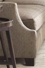 Sleek Curving Lines with Nail Head Accents Provide Up-Scale Fashion to Living Room Settings