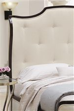 The Sleigh Bed's Button-Tufted Winged Headboard Creates a Striking Silhouette with a Luxurious Feel