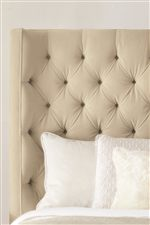 Diamond Button Tufting On the Upholstered Bed Headboard Creates a Plush, Traditional Look
