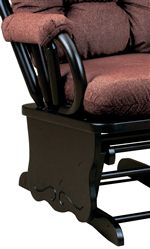 A Gliding Rocker Base with Carved Detail and an Exposed Wood Arm with Cushion are Features of the Collection
