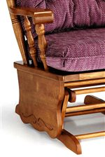 A Gliding Base with Carved Detail, Turned Spindles, and Exposed Wood Arm are Features of the Glide Rocker