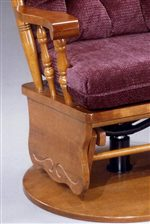An Optional Swivel Gliding Base with Carved Detail, Turned Spindles, and Exposed Wood Arm are Features of the Glide Rocker
