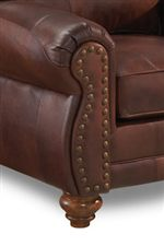 Rolled Arm and Nailhead-Studded Faceplates Flow into Turned Wood Legs
