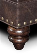 Base Adorned with Larger Nailheads and Turned Wood Feet