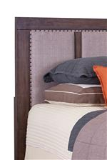 Headboard Features Upholstered Panels Bordered by Nailhead Trim