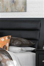 Upholstered Headboard Features Bolster Detail