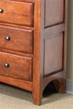 Framed Panels and Curved Bottoms Add a Unique Look to this Dresser.
