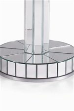 Detail of glass end table with reflecting mirror