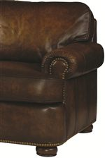 Thick Upholstered Cushions Blend with Nail Head Trim to Create a Style that is Lavish and Comfortable