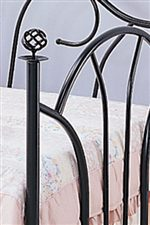 Filigree Knobs and Elegant Fan Shaped Footboard