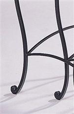 Black iron base cabriole legs.