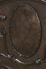 Ornate Oval Cameos on the Headboard and Fretboard Add Traditional Style and Grace