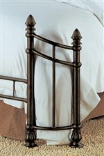 Beautiful Wraparound Footboard Design Accented with Pineapple Finials and Fluted Feet