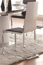 Tall Seat Backs and Curved Chrome Legs on Dining Chair
