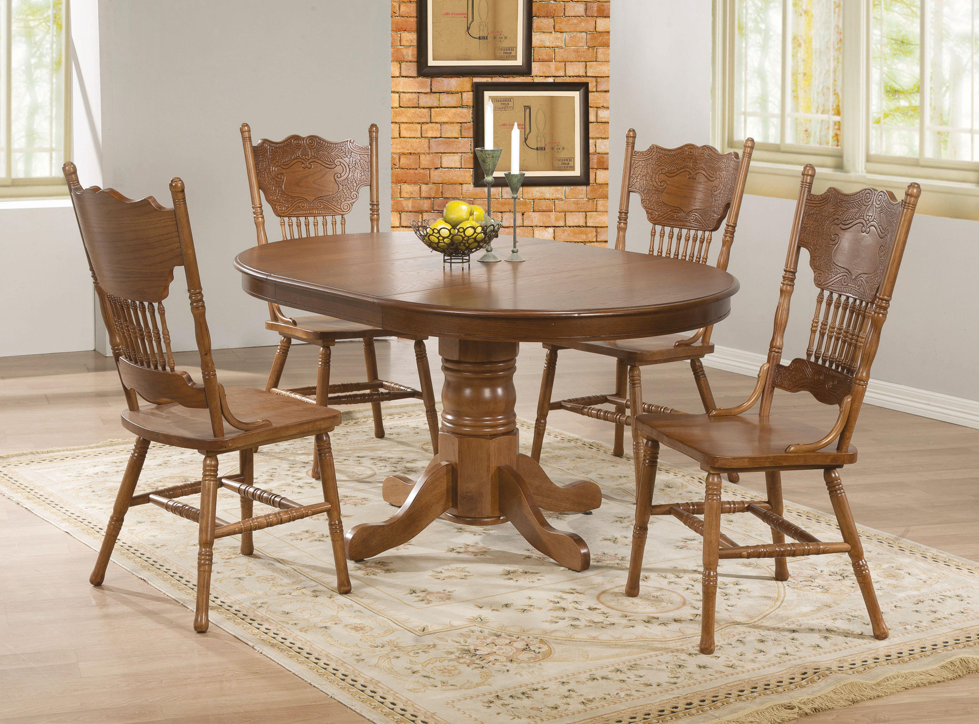 Oak dining room chairs - Coaster Brooks Oak Finish Round Oval Dining Table With Single Pedestal Decorative Apron Value City Furniture Dining Tables