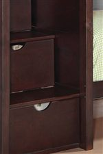 Three Drawers are Located within Staircase for Ample Storage Space