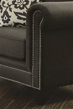 Rolled Arms and Pewter Nailheads Bridge the Gap Between Traditional and Chic Transitional Design