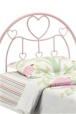 Pink Metal Frame Bed with Whimsical Feminine Design