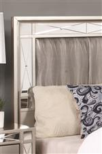 The Headboard Showcases the Etched Mirror Panels Featured Throughout the Collection, as well as the Metallic Leatherette