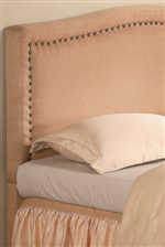 Subtle Curves are Enhance with Nailhead Trim