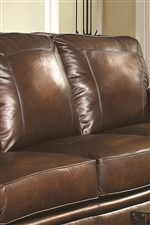 Hand Rubbed Brown Leather and Framed Stitching on Back Cushions