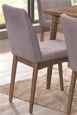 Conical Legs Create Mid Century Modern Style Alongside Chic Grey Side Chairs