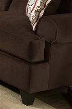 Smooth Pulled Upholstery Blends with Rounded Arms and Tapered Legs to Create a Look of Casual Design