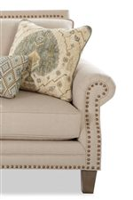 Sophisticated Glamour is Expressed in All-Over Nailhead Trim and Flared, Rolled Arms